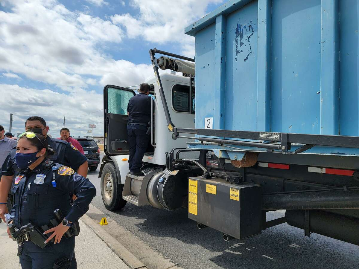 Laredo police officers are seen at a shooting incident, where a suspect shot at a City of Laredo Solid Waste truck driver along Bob Bullock Loop.