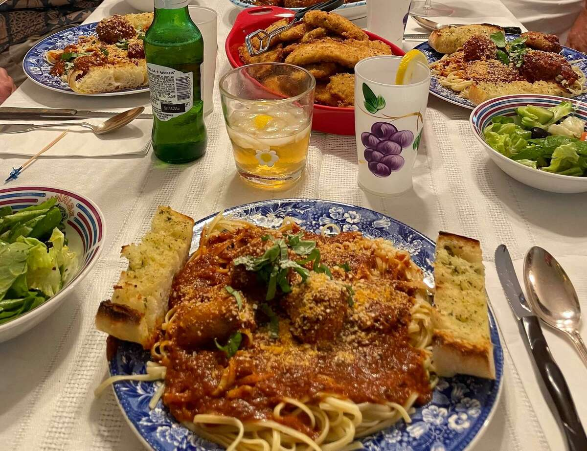 """This meal of Pete Leonetti's is the cover picture for he and his wife's new Facebook group, """"Karen and Pete's Wooster Street Family."""" The meal includes linguini with meatballs and sausage, garlic bread, salad with oil and vinegar broccoli rabe, fried chicken cutlets - and pie for dessert."""