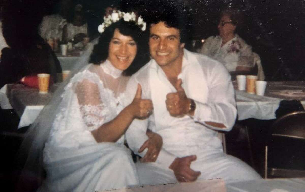 Karen and Pete Leonetti give a thumbs-up on their wedding day.