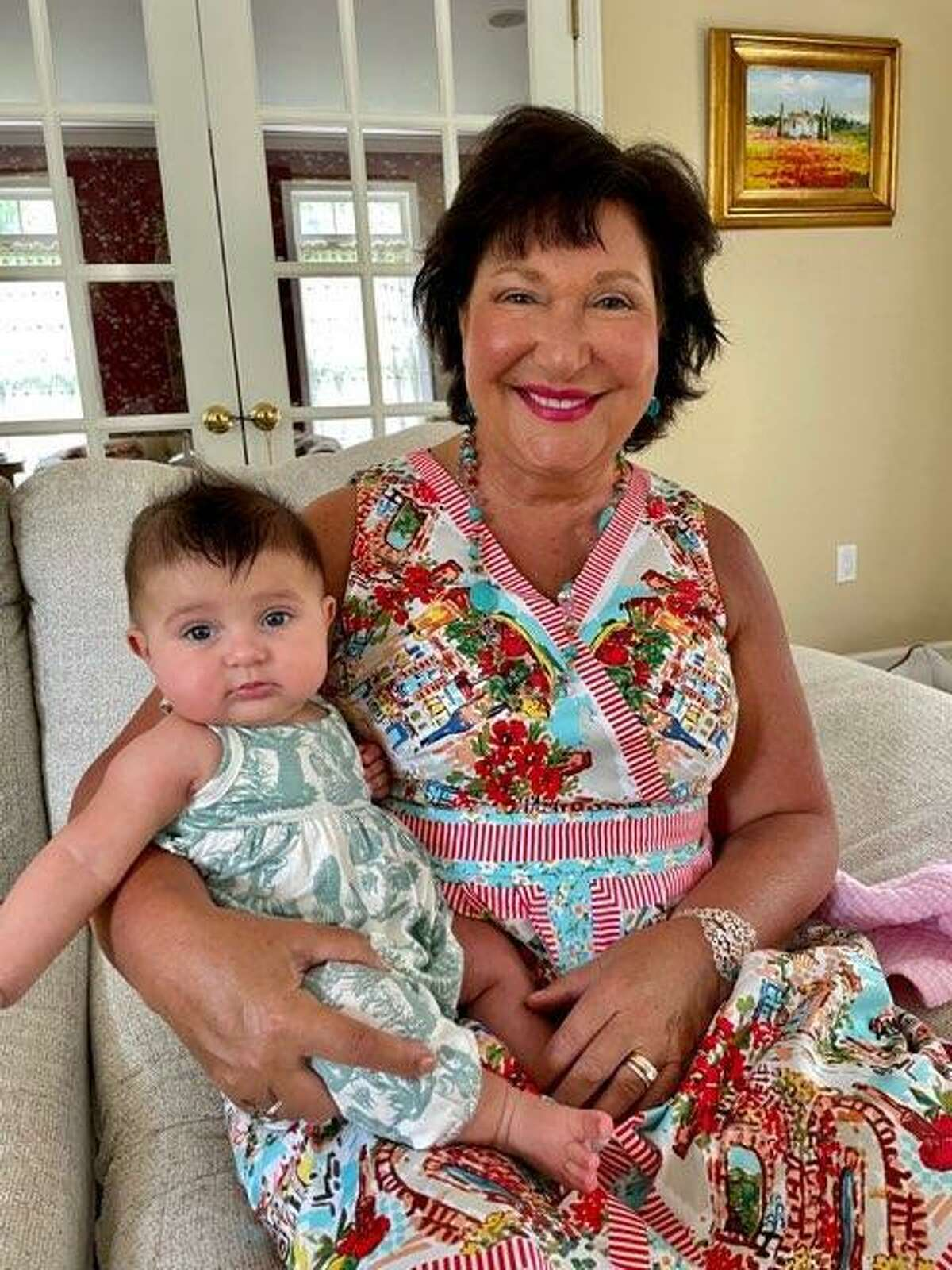 """Karen Leonetti of Madison with her granddaughter, Alessia, who lives in New Jersey. Leonetti has started a Facebook group, """"Karen and Pete's Wooster Street Family,"""" that emphasizes food and recipes, but also family."""