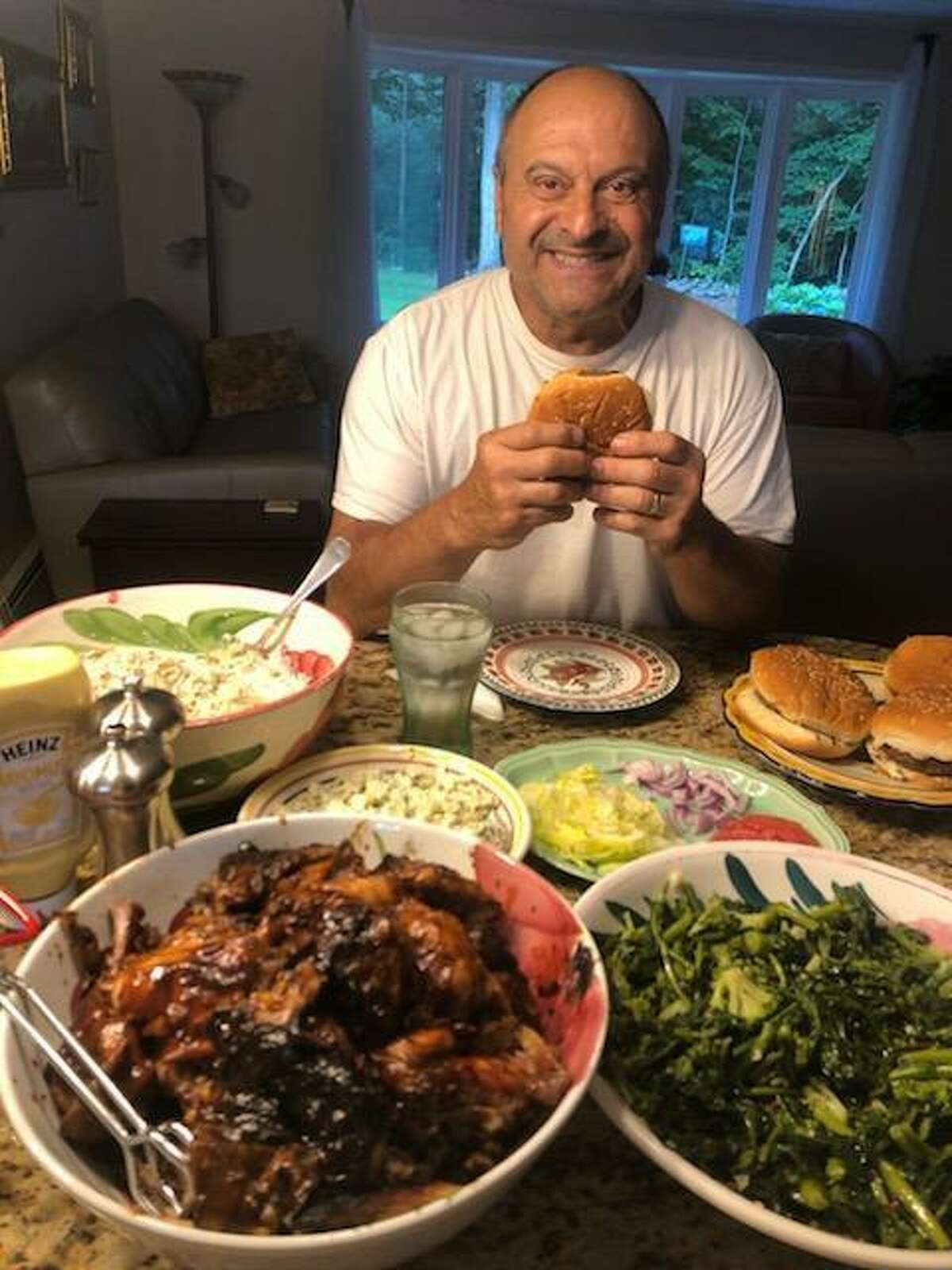 """Pete Leonetti sits down to another feast prepared by his wife of 39 years, Karen Leonetti. Pete and his meals have become a Facebook sensation, fist through the popular Facebook group, """"Wooster Square Cooks,"""" and now through Karen Leonetti's new Facebook group, """"Karen and Pete's Wooster Street Family."""""""