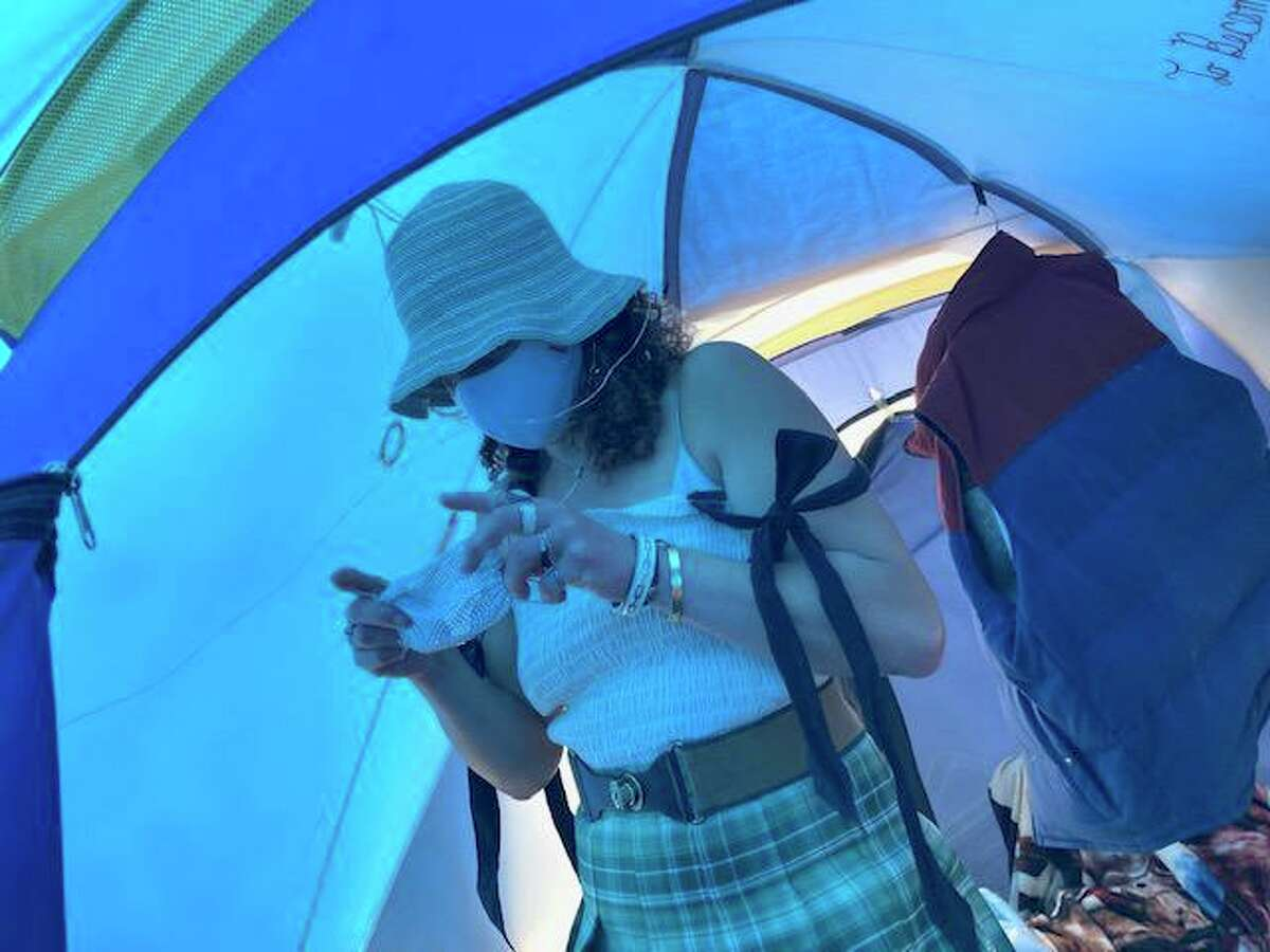 Jacqueline Smith, 29, in her tent at 33 Gough St. in San Francisco. The safe sleeping tent campsite for the homeless will soon be converted into a site for cabins for the homeless.