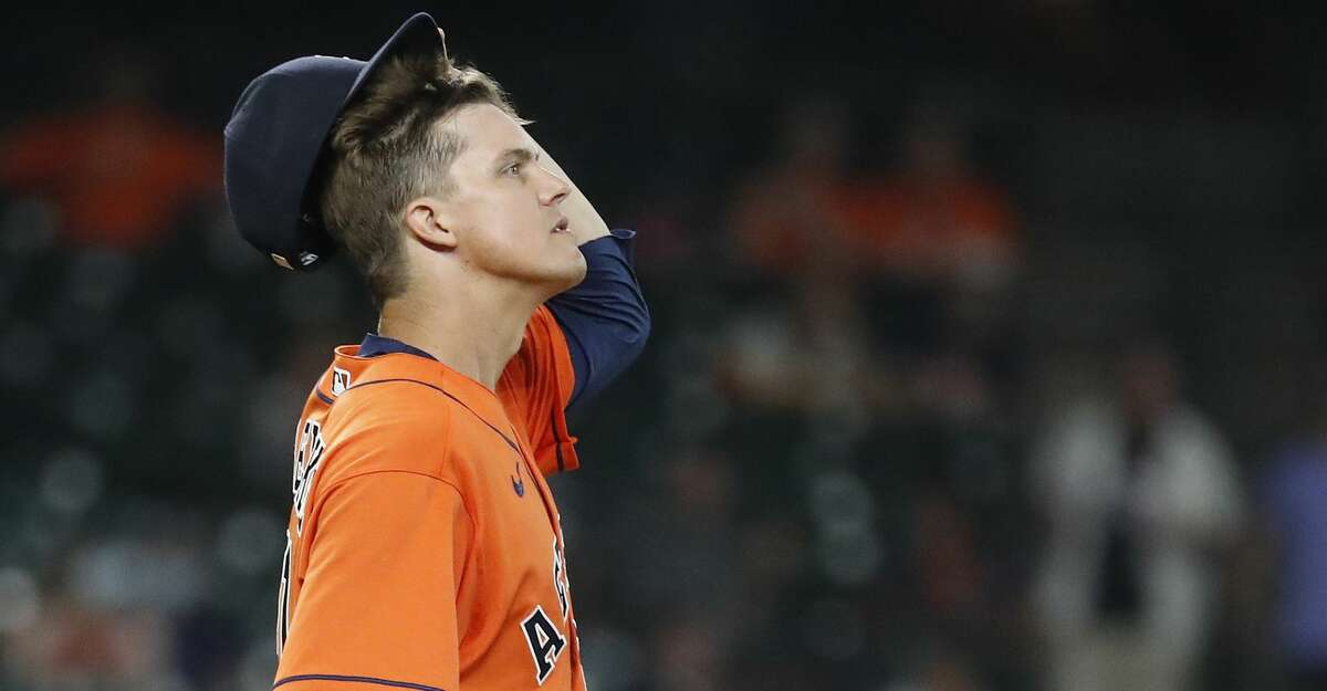 Houston Astros starting pitcher Zack Greinke (21) reacts after walking Minnesota Twins Max Kepler (26) during the third inning of an MLB baseball game at Minute Maid Park, Friday, August 6, 2021, in Houston.
