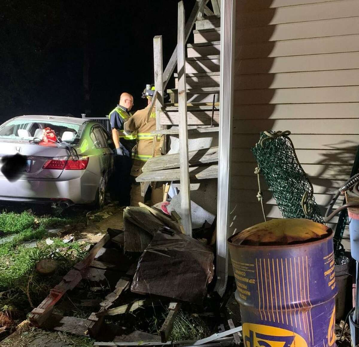 Shelton firefighters and emergency personnel arrived at the Waverly Road home about 8 p.m. Monday, Sept. 20, 2021, finding a sedan in the rear yard wedged between the home and a large wood pile. The driver needed to be removed from the vehicle and transported to the hospital for evaluation.
