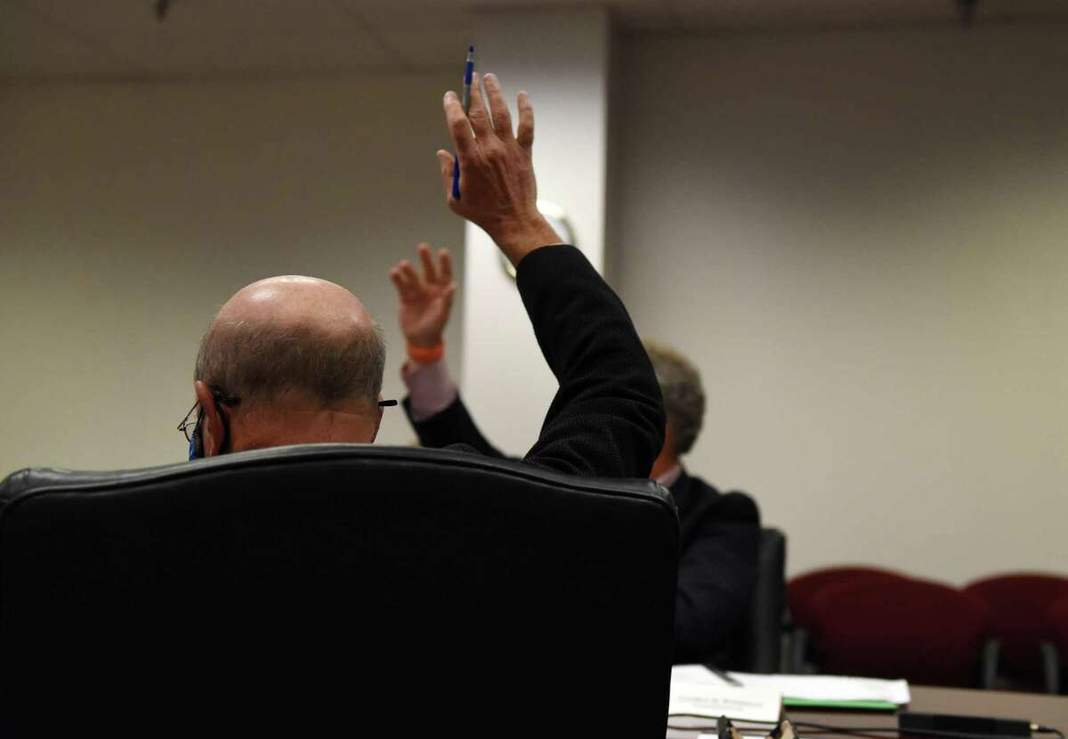 New York State Joint Commission on Public Ethics commissioners vote on a motion during the public portion of the group?•s meeting on Tuesday, July 27, 2021, at the JCOPE offices in Albany, N.Y. (Will Waldron/Times Union)