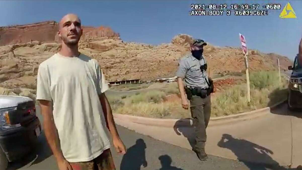"""Image from Moab Police Department shows Brian Laundrie talking to a police officer after police pulled over his van. Riding with him was his girlfriend, Gabrielle """"Gabby"""" Petito (right)."""