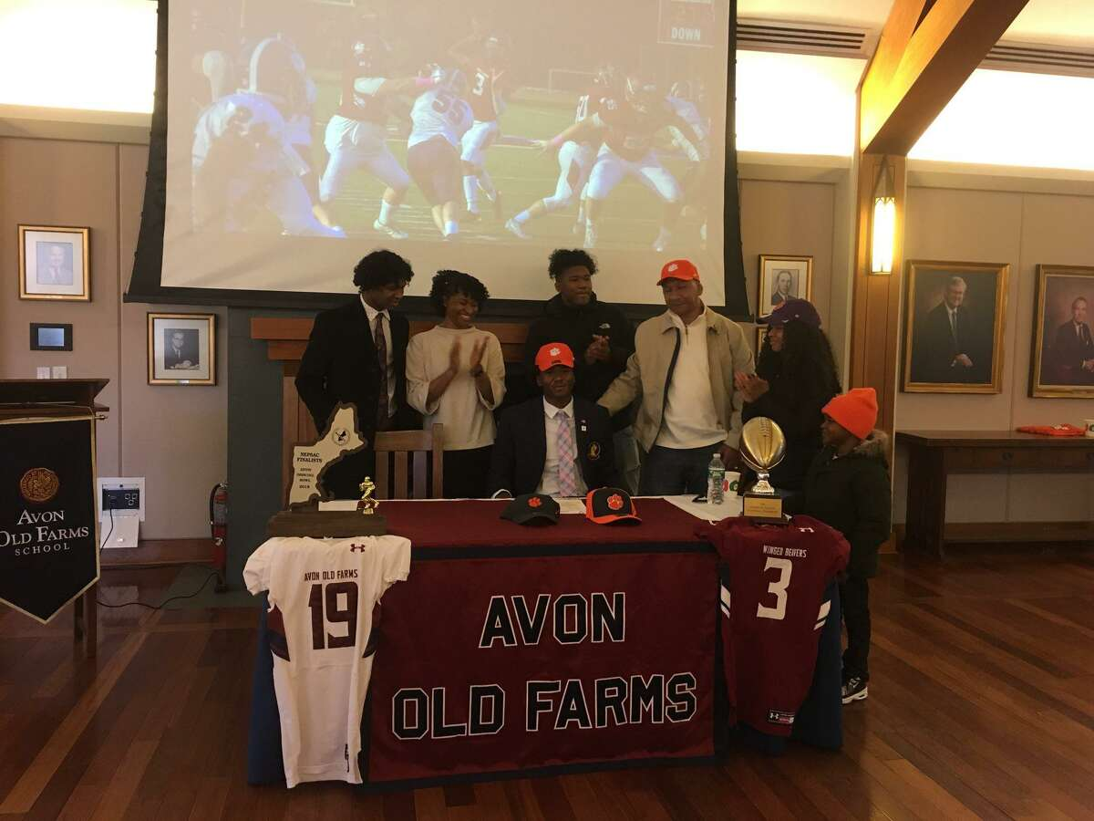 Taisun Phommachanh signs natonal letter of intent with Clemson, surrounded by family at Avon Old Farms