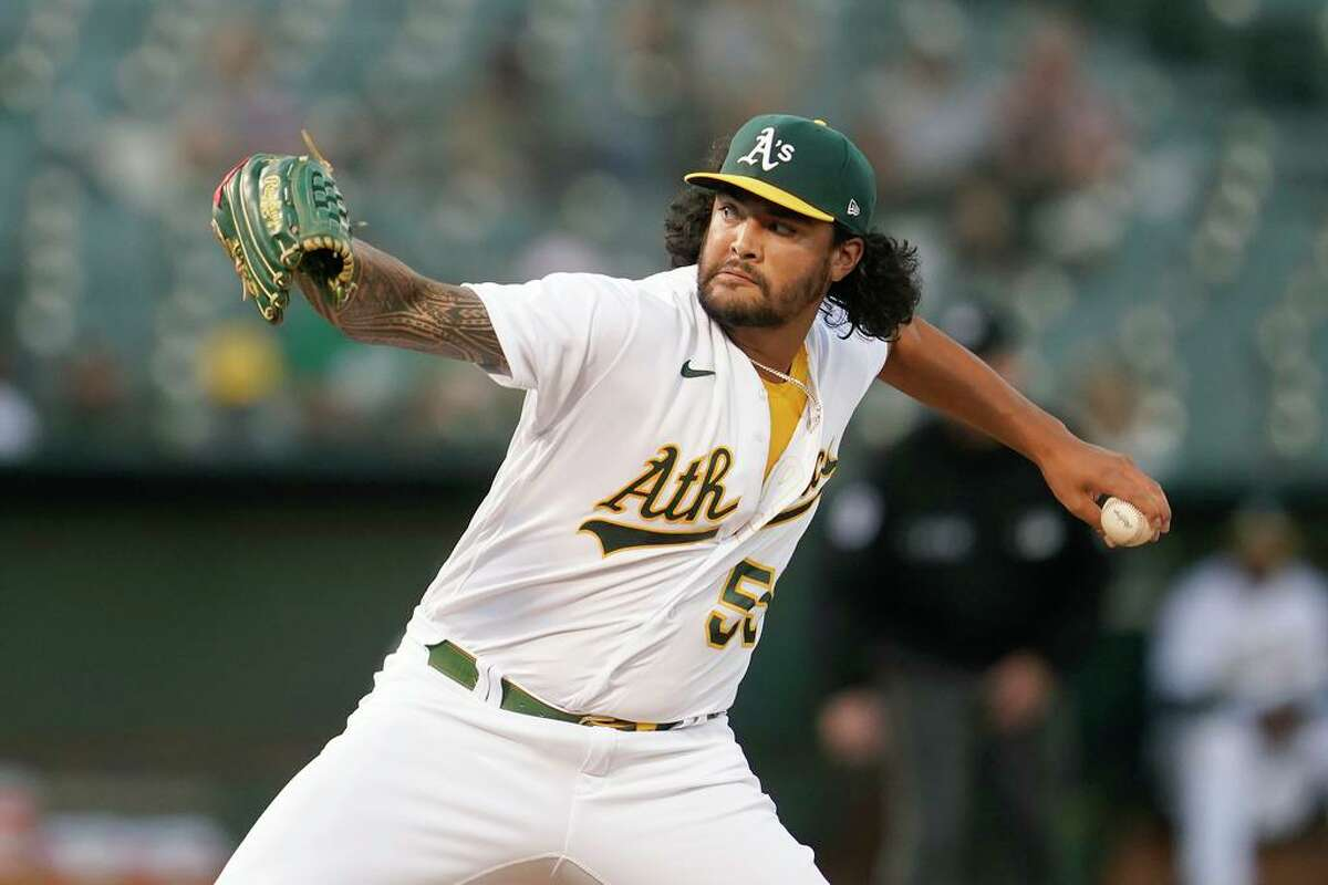 Oakland Athletics' Sean Manaea pitches against the Seattle Mariners during the first inning of a baseball game in Oakland, Calif., Monday, Sept. 20, 2021. (AP Photo/Jeff Chiu)