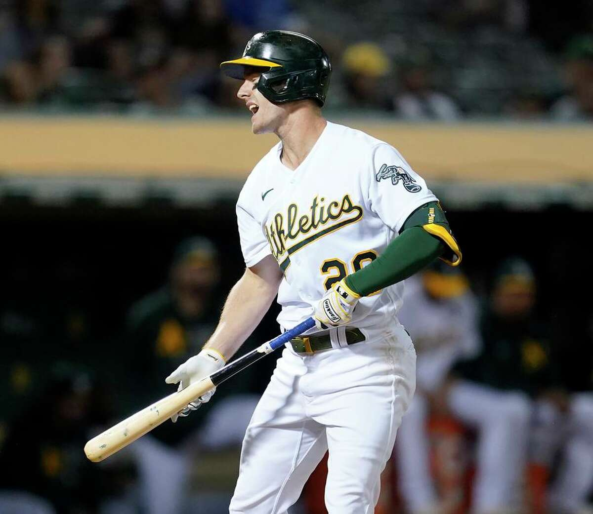 The A's Mark Canha reacts after striking out against the Seattle Mariners during the seventh inning at the Coliseum.