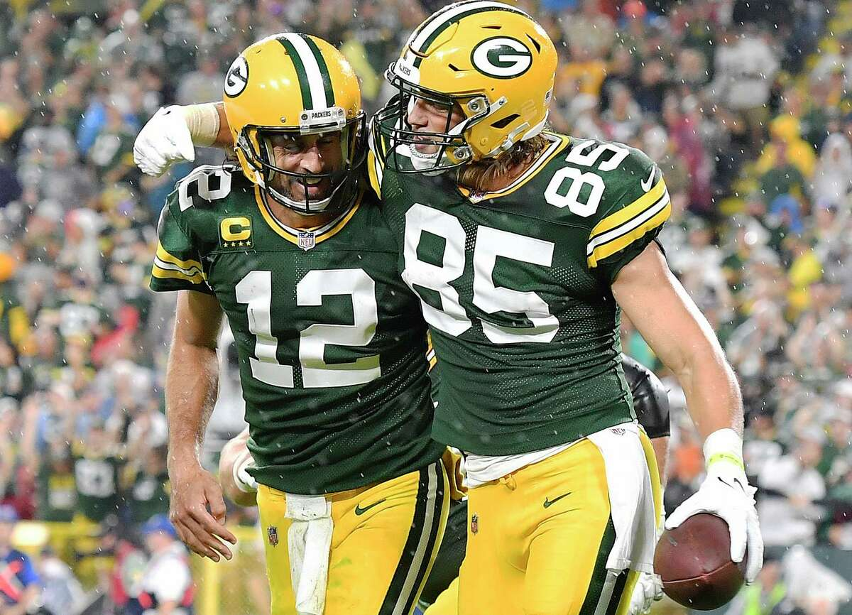 Robert Tonyan (85) and Aaron Rodgers celebrate a Green Bay score against the Lions. Rodgers, the former Cal quarterback, threw four touchdown passes, three of them to Aaron Jones.