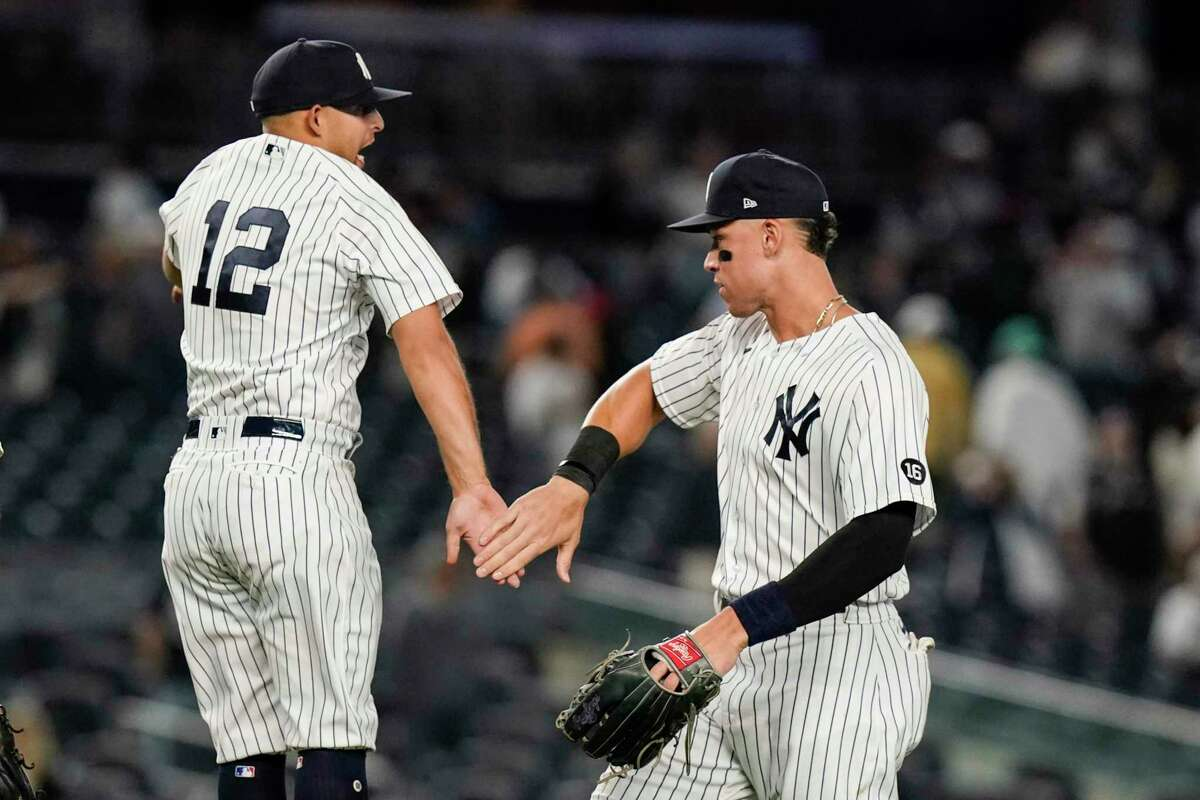 New York Yankees' Rougned Odor, left, celebrates with Aaron Judge after a baseball game against the Texas Rangers, Monday, Sept. 20, 2021, in New York. (AP Photo/Frank Franklin II)