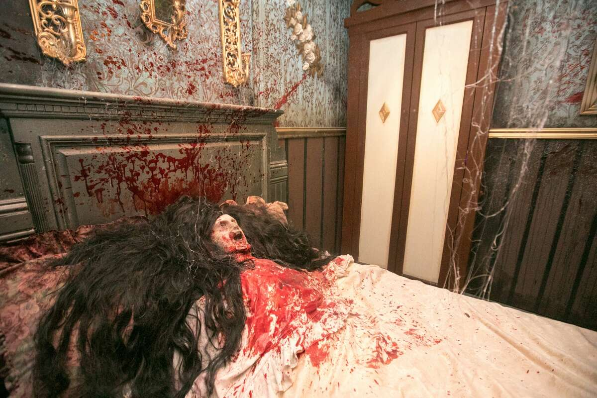 """One of the halls of an immersive haunted attraction, """"The Immortal Judgment,"""" at the San Francisco Mint on September 13, 2021. (This is one of Peaches Christ's old wigs.)"""
