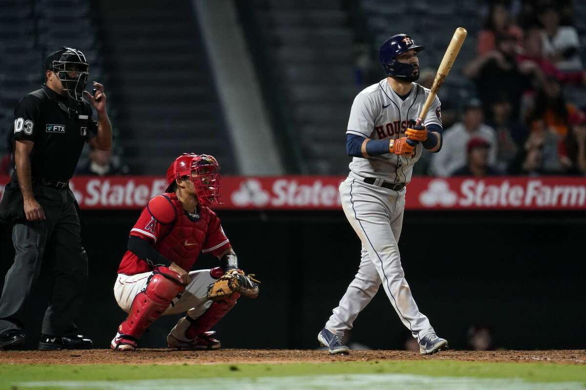 Houston Astros' Marwin Gonzalez follows through on his grand-slam home run during the ninth inning of a baseball game against the Los Angeles Angels Monday, Sept. 20, 2021, in Anaheim, Calif. (AP Photo/Marcio Jose Sanchez)