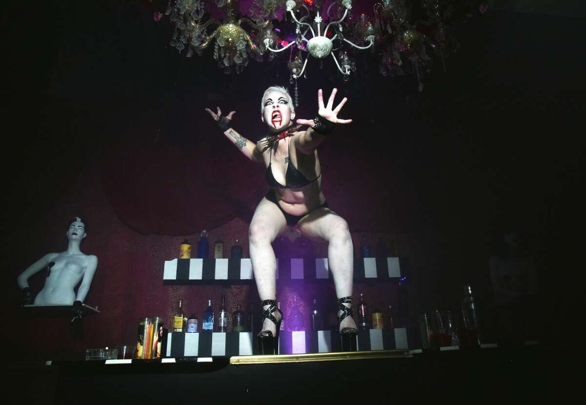 """Former Lusty Lady dancer Roxanne Redmeat dances at """"Croc-bang"""" disco inside """"The Immortal Judgment"""" at the San Francisco Mint."""