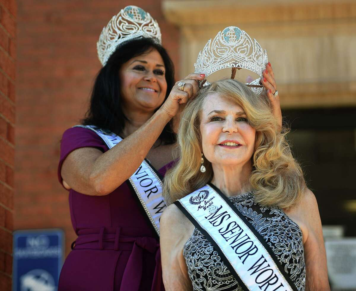 Ms. Senior World 2021 Dreisa Sherrill, left, of Myrtle Beach, S.C., crowns Noreen Adams of West Haven as Ms. Connecticut Senior World outside City Hall in West Haven Sept. 20, 2021.