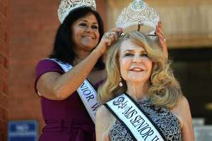 Ms. Senior World 2021 Dreisa Sherrill, left, of Myrtle Beach, South Carolina, crowns Noreen Adams, of West Haven, Ms. Connecticut Senior World outside City Hall in West Haven, Conn. on Sept. 20, 2021.