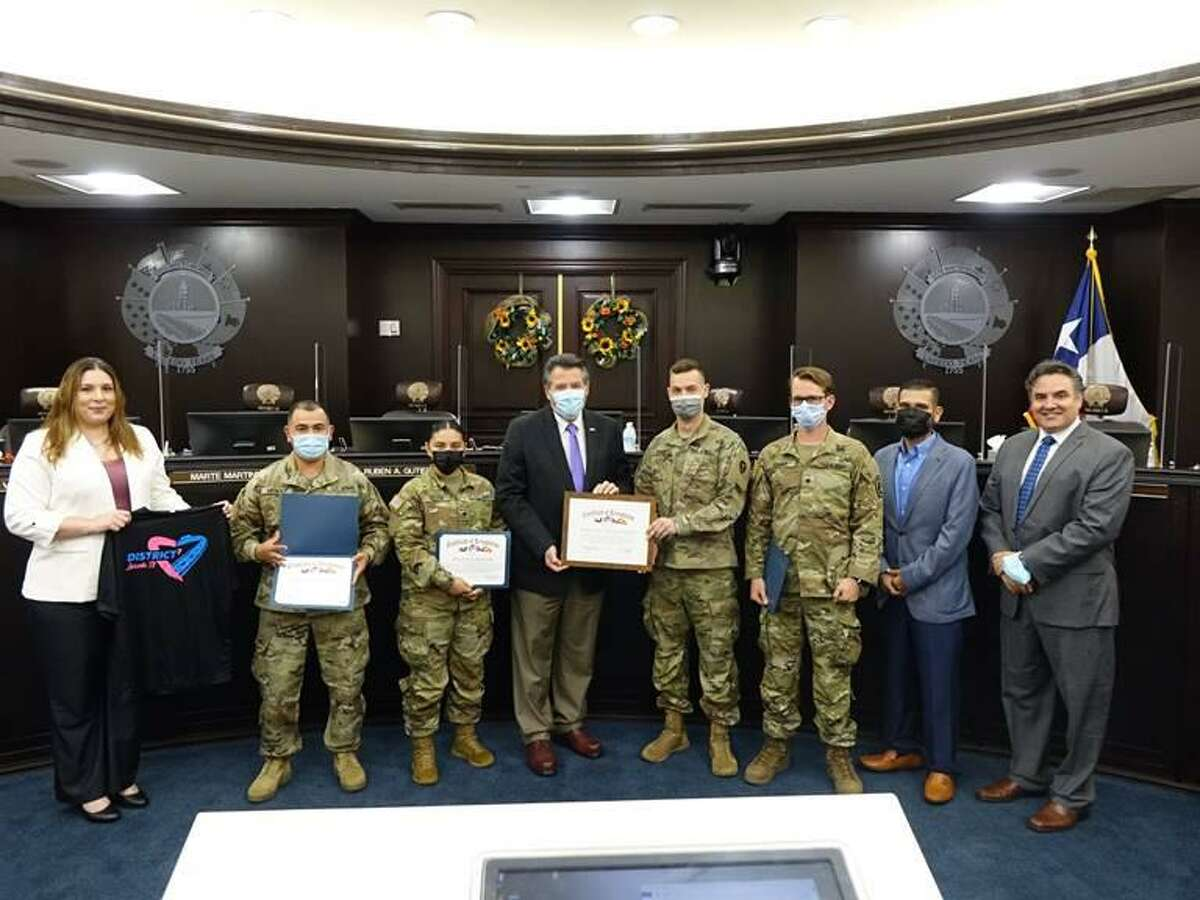 City of Laredo Councilmember for District VII Vanessa Perez, Mayor Pete Saenz, Councilmember for District II Rudy Gonzalez and Councilmember for District VI Dr. Marte Martinez are pictured with the National Guard Mobile Vaccination Team Y2.