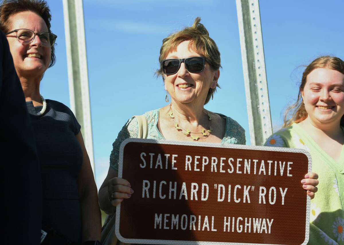 """Pat Roy, center, attends the ceremony honoring her late husband, former State Rep. Richard """"Dick"""" Roy, naming a bridge across the Oyster River in his name in Milford, Conn. on Monday, September 20, 2021. At left is Milford State Rep. Kathy Kennedy."""