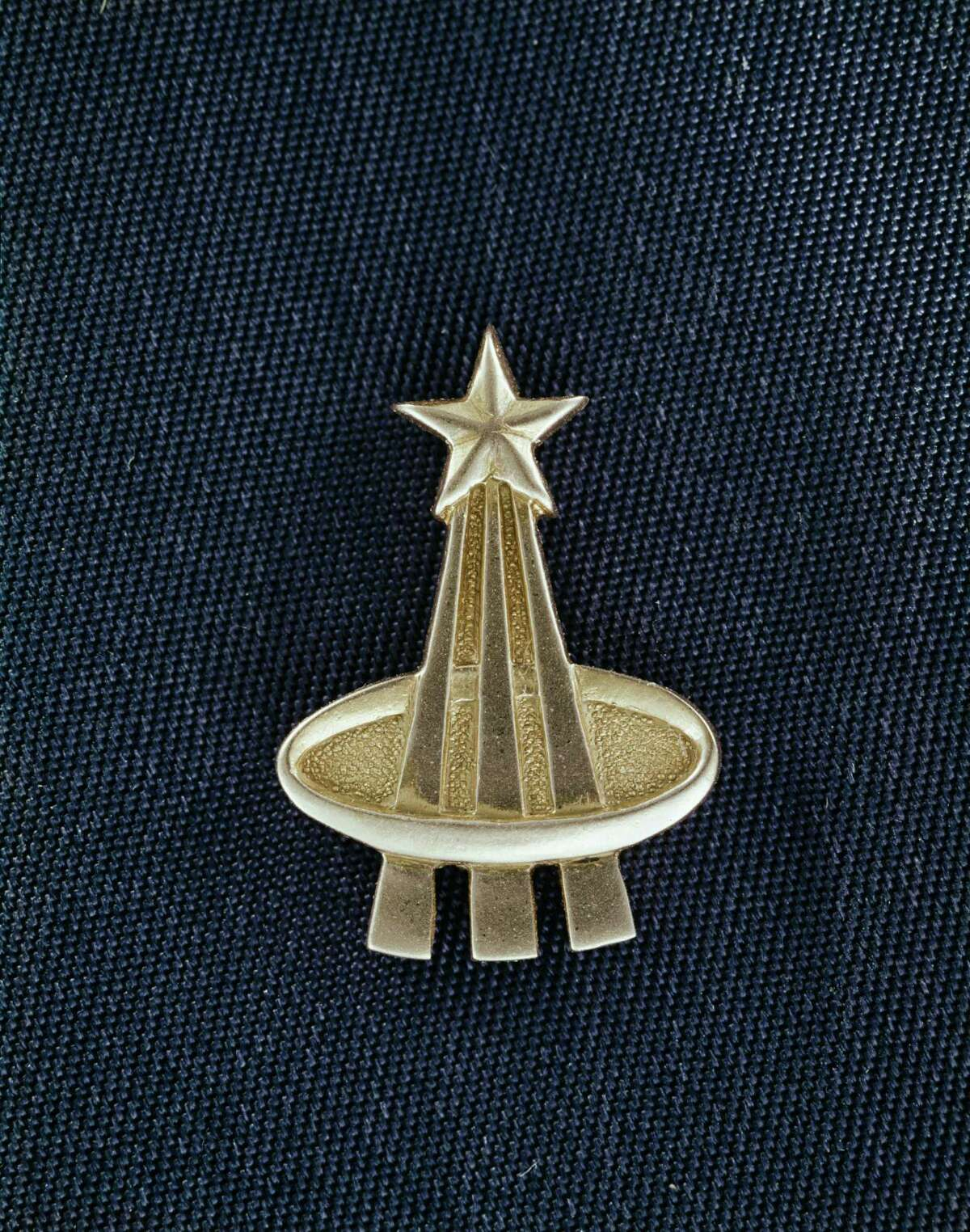 The gold pin that NASA astronauts receive after their first flight into space.