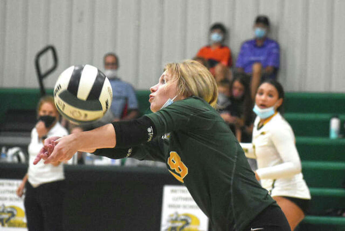 Metro-East Lutheran libero Sidnee Schwarz receives a serve against the Litchfield Panthers during the second game on Monday inside Thomas Hooks Gymnasium.