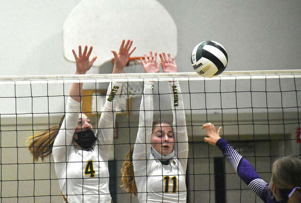 Metro-East Lutheran's Lexi Bozarth, right, and Emma Lorenz team up for a block against the Litchfield Panthers during the second game on Monday inside Thomas Hooks Gymnasium.