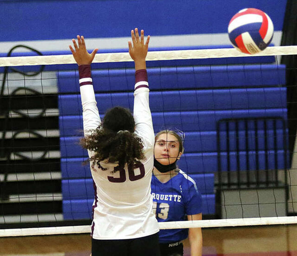Marquette Catholic's Olivia Ellebracht (right) watches her attack go past the block by EA-WR's Reaghan Williams (36) in an August match at the Roxana Tourney. The Explorers were back at Roxana on Monday night and Ellebracht had a season-high eight kills in a three-set win over the Shells.