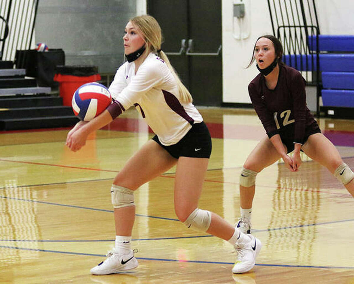 EA-WR's Ali Sidwell (left) receives a serve in front of libero Zenn Wilson during a match in August at the Roxana Tourney. On Monday night in Glen Carbon, Sidwell led the Oilers past Father McGivney in three sets.