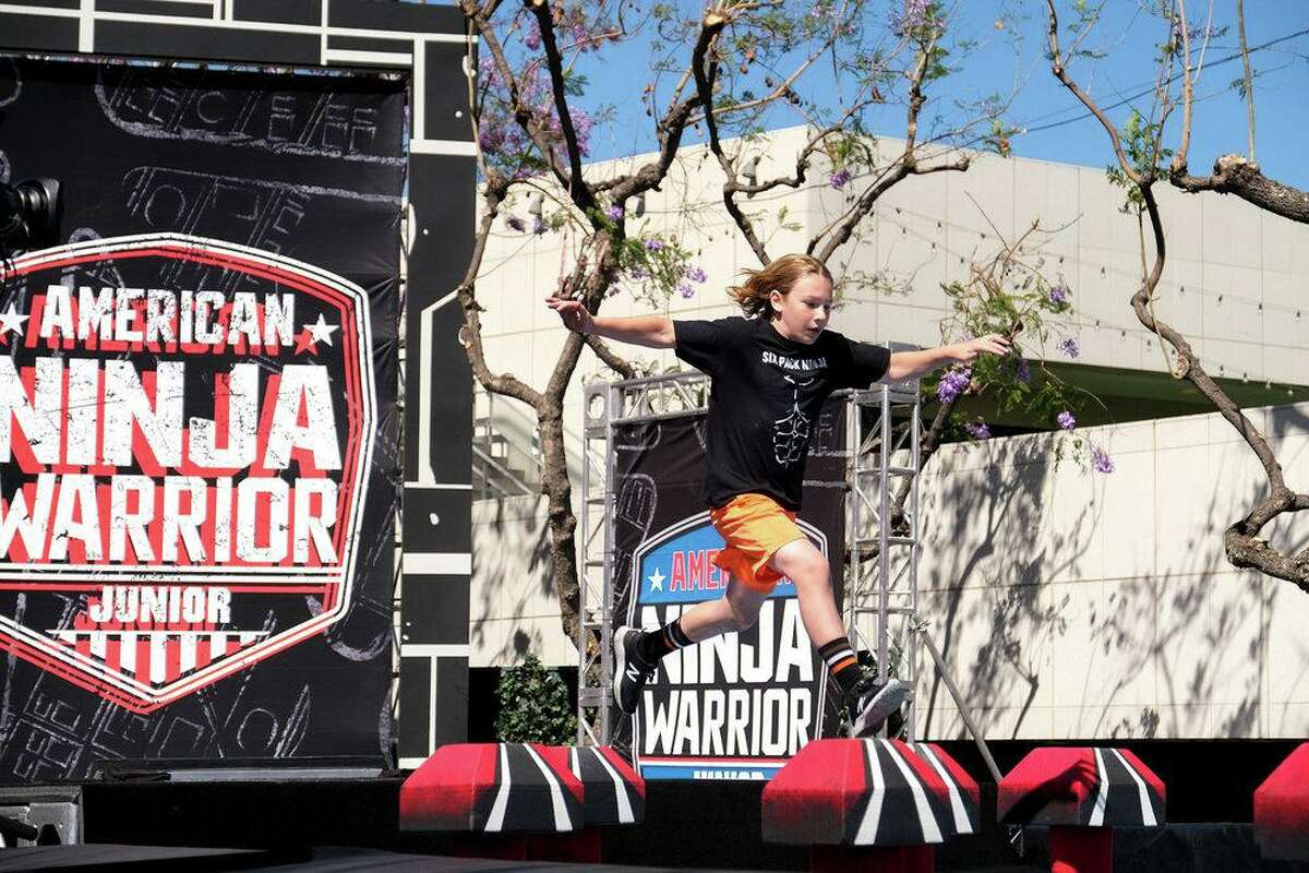 """Jake Scionti of Trumbull competes on the obstacle course challenge show """"American Ninja Warrior Junior."""""""