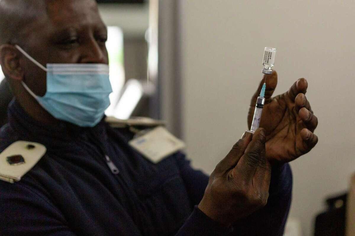 A health worker prepares a dose of the Johnson & Johnson covid-19 vaccine.