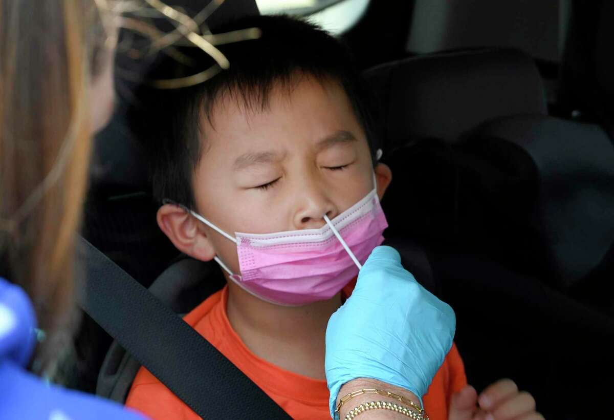 Nathan Bian, 5, gets swabbed for a rapid COVID-19 test on Tuesday, Aug. 24, 2021. (Brittany Murray/The Orange County Register/SCNG via AP)