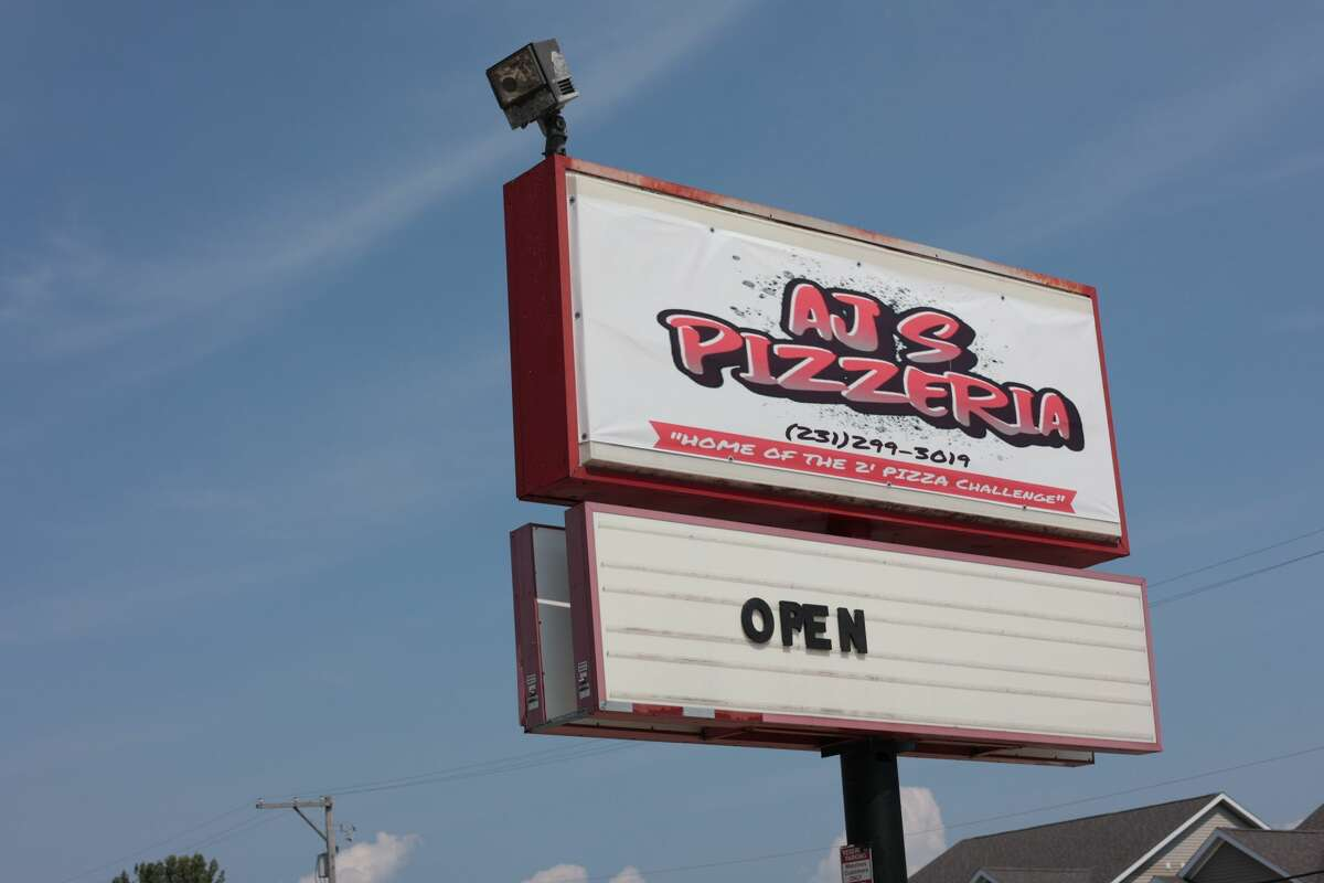 """The sign at 34 Arthur St. in Manistee said AJ's Pizzeria, """"Home of the 2' Pizza challenge."""" That challenge is to eat a 2-foot pizza and succeed and be placed in the """"hall of fame"""" or fail to finish the pizza and become placed in the """"hall of shame."""""""