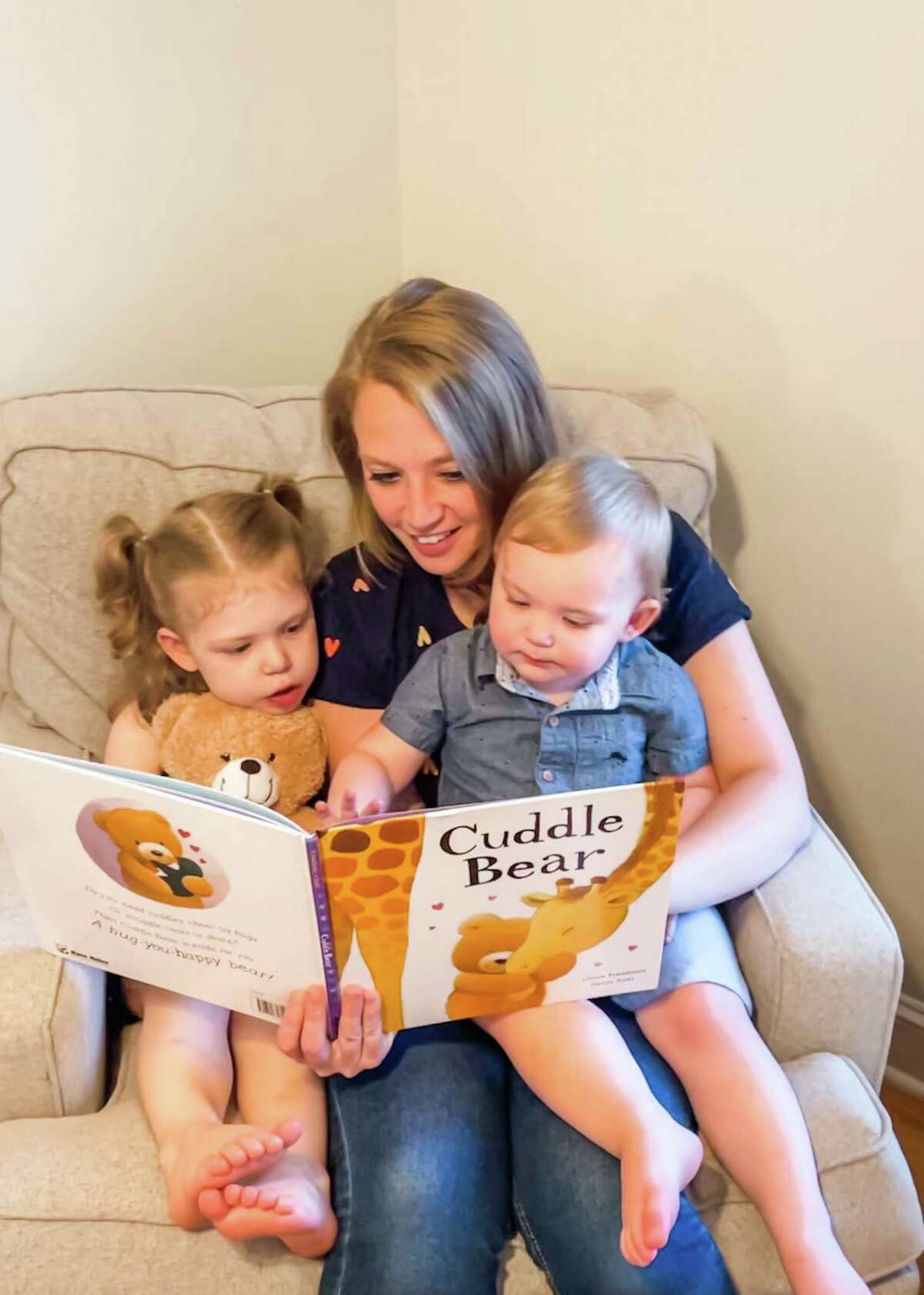 """Jaclyn Brunetto and her children read """"Cuddle Bear,"""" the book that the kindergarten teacher is donating to Wilton's Circle of Care nonprofit."""