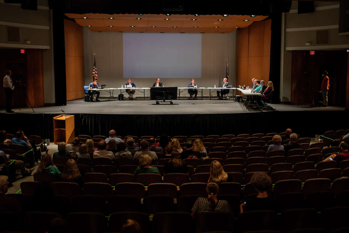 Members of the public listen during a meeting of the Midland Public Schools Board of Education Monday, Sept. 20, 2021 at Central Auditorium in Midland. The meeting included a presentation from physicians from MidMichigan Health, followed by a public comment session during which many debated about masking in schools. (Katy Kildee/kkildee@mdn.net)