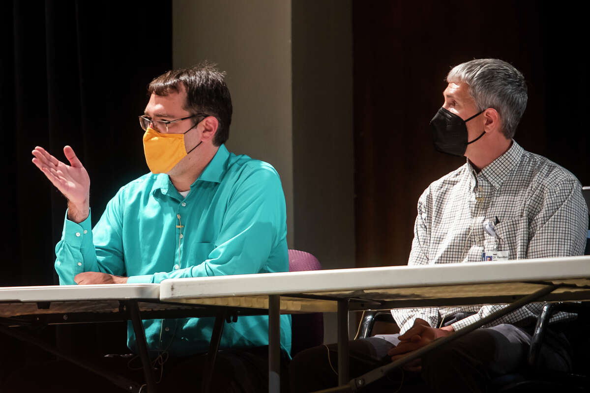 Dr. Michael Elftman, left, speaks while giving a presentation alongside MidMichigan Health physician Dr. Adam Hamilton, right, on the current state of the COVID-19 pandemic during a meeting of the Midland Public Schools Board of Education Monday, Sept. 20, 2021 at Central Auditorium in Midland. (Katy Kildee/kkildee@mdn.net)
