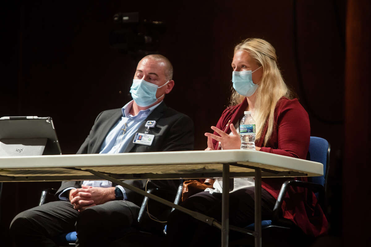 MidMichigan Health physician Dr. Courtney Pearson, right, speaks while giving a presentation on the current state of the COVID-19 pandemic during a meeting of the Midland Public Schools Board of Education Monday, Sept. 20, 2021 at Central Auditorium in Midland. (Katy Kildee/kkildee@mdn.net)