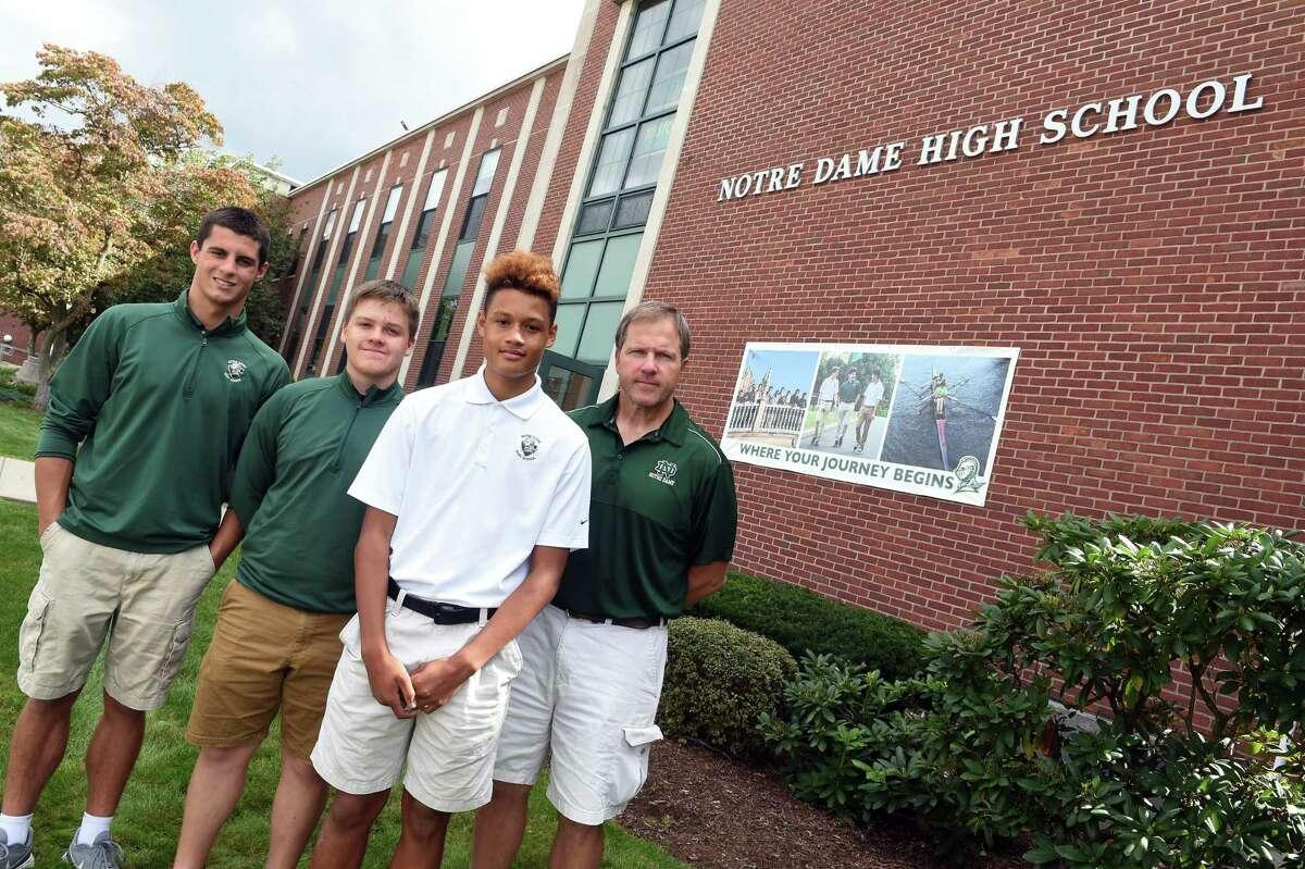 From left, senior Luke Beerli, 16, sophomore Peter Swanson, 15, junior Cayden Drost, 16, and social studies teacher Adam Laput are photographed in front of Notre Dame High School in West Haven Sept. 17, 2021.