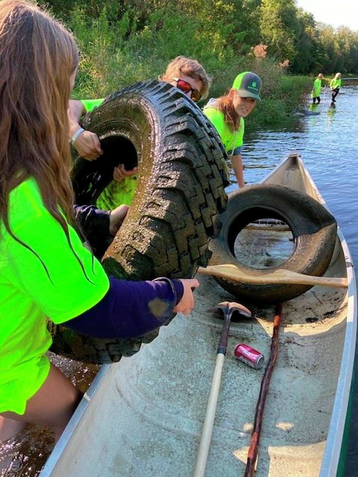 Tuscola County 4-H Youth Council kids were hard at workextracting tires and other trash fromthe Cass River last Saturday. (Tom Lounsbury/Hearst Michigan)