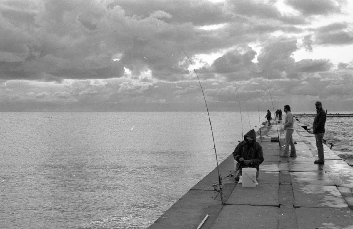 Anglers could be seen sittingon the south pier on a chilly September morning in 1981. (Manistee County Historical Museum photo)