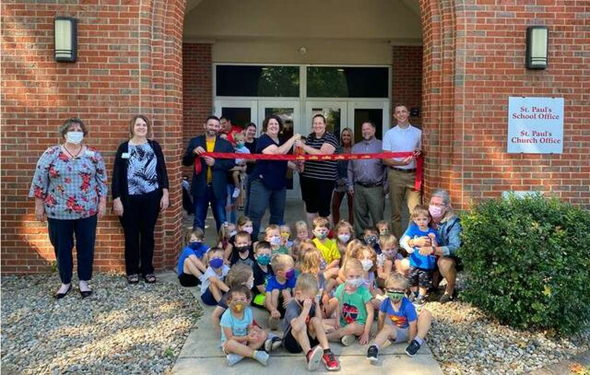 St. Paul's Lutheran Early Childhood Center in Troy celebrated its grand opening on Sept. 14. Pictured with students are Jason Kesterson, Co-Chair of the ECC Board; Rev. Albert Collver; Susan Lilienkamp, Director; Elizabeth Meschke, Assistant Director; and David Thomas, Co-Chair of the ECC Board.