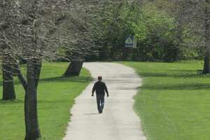A hiker makes his way down the trail at LaVista Park in Godfrey. The village will receive a $300,000 grant for Phase 3 work on the Fred E. Widman Trail from the Metro East Park and Recreation District.