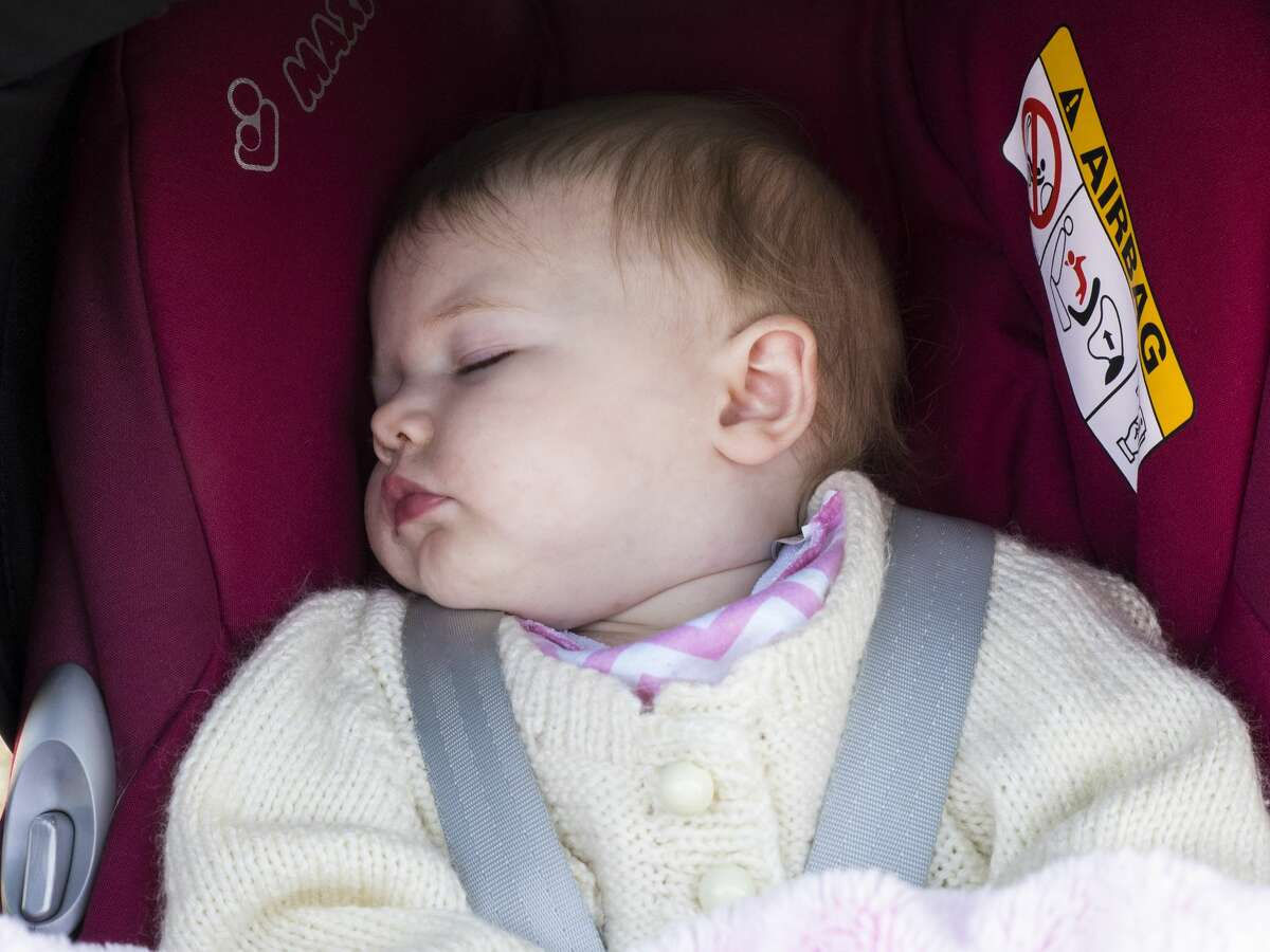 FILE - A baby sleeps in her pushchair. (Photo by: Nik Taylor/Education Images/Universal Images Group via Getty Images)