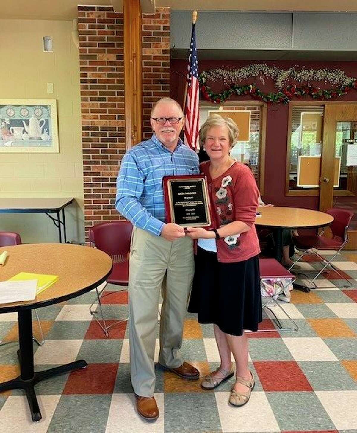 Pictured is Big Rapids Housing Commission President, Dan Farrow, presenting Beth Krueger with a plaque honoring her service to the Big Rapids Housing Commission. (Submitted photo)