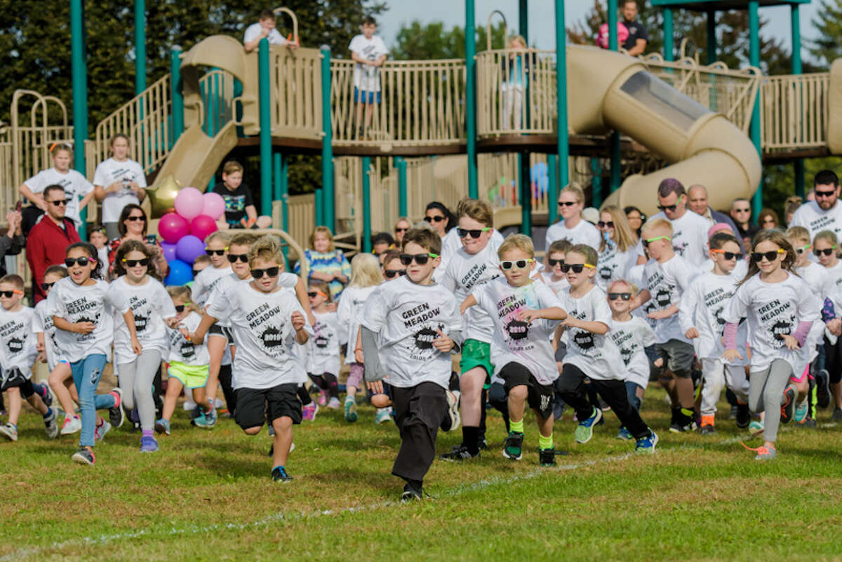 Green Meadow elementary students begin the annual Color Run.