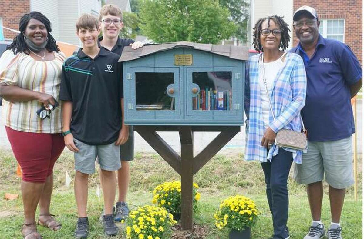 Pictured with a new Free Little Library in Alton are, from left, Apryll Pittman, Jacob Schaper, Blake Schaper, Stephanie Elliott and Joe Elliott.