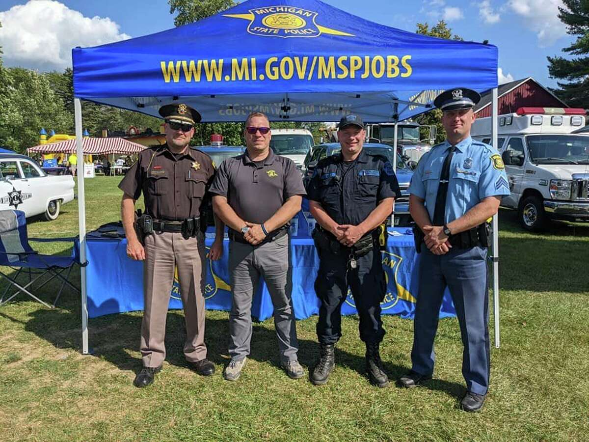 Lake County Sheriff Rich Martin, pictured far left, joined many other police officers and public safety personnel for a fundraiser in support of the Great Lakes Burn Camp. (Courtesy photo)