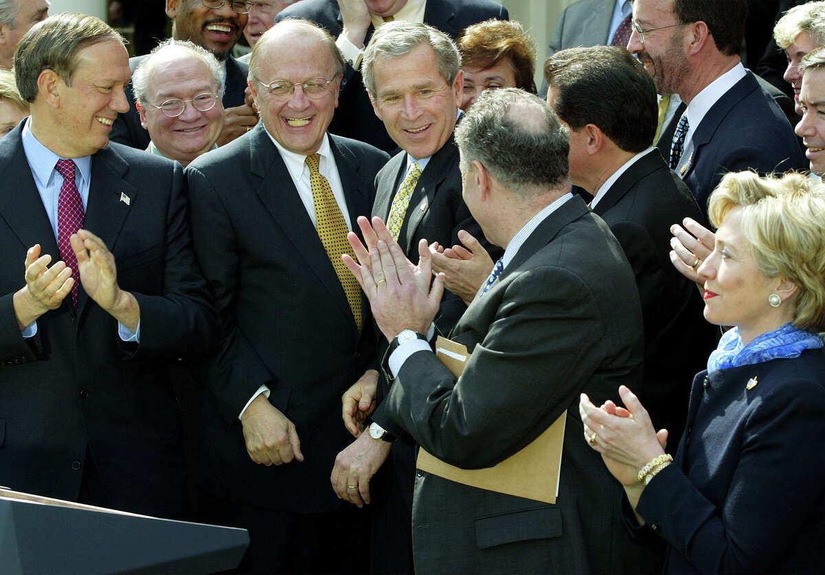 Then-President Bush walks into the Rose Garden and is surrounded by members of the New York Delegation, Thursday, March 7, 2002. From left to right, Gov. George Pataki, Gary Ackerman D-NY, Sherwood Boehlert, R-NY, Sen. Chuck Schumer, D-NY, Sen. Hillery Clinton, D-NY. Bush delivered the $20 billion in U.S. government aid he promised New York for its recovery from the Sept. 11 terrorist attacks.