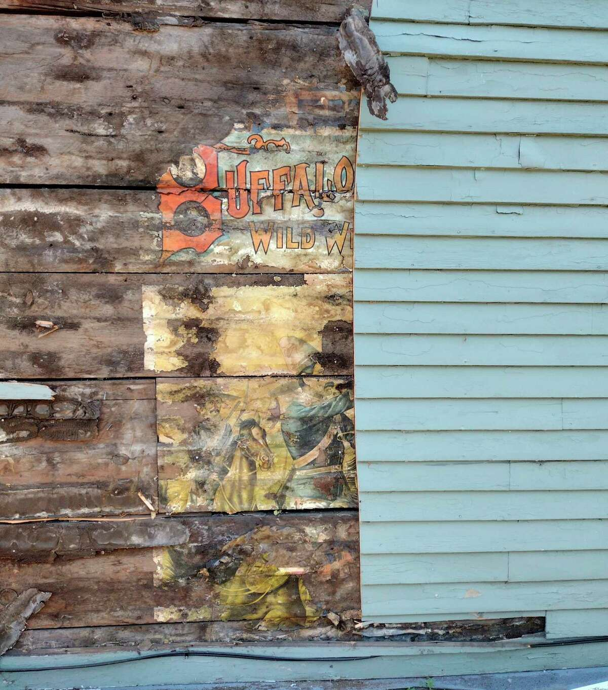 While removing siding from a Manistee building, Jesse VanderBie of Jack VanderBie Builders, LLC, began to uncover a poster fromBuffalo Bill's Wild West and Congress of Rough Riders of the World Show, which came to Manistee in 1898 and 1916. (Courtesy photo)