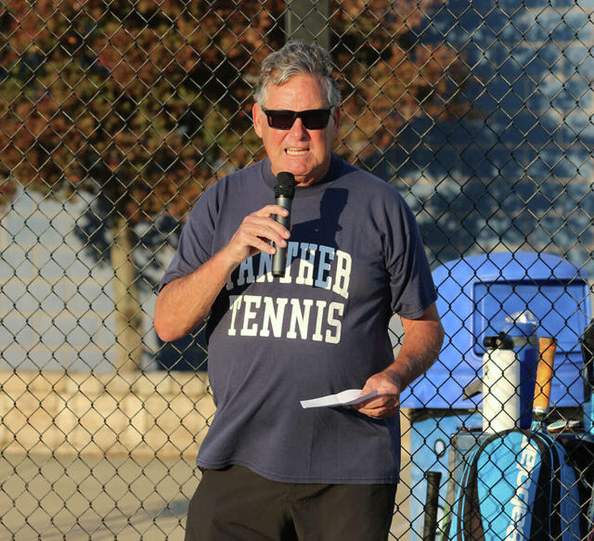 Pat Coyle addressing the crowd during the dedication of Pat Coyle Court at the Jersey High tennis facility in Jerseyville on Monday. Coyle, who coached both boys and girls tennnis for the Panthers, spent 33 years as a teacher with the last 21 of those years serving as the school's athletics director.