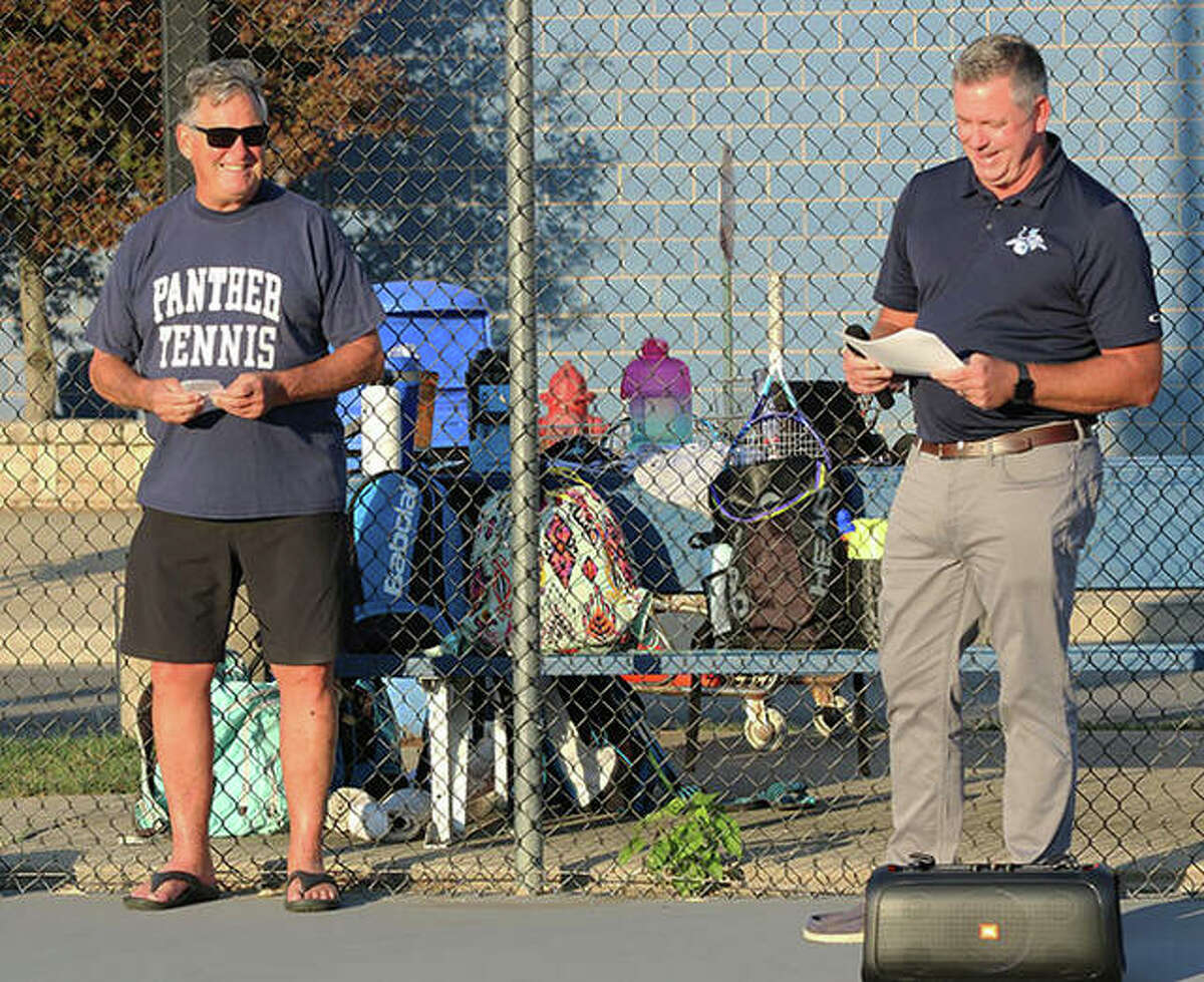 Jersey girls tennis coach Dan Diamond (right) reads the tribute for Pat Coyle (left) on Monday at Jerseyville.