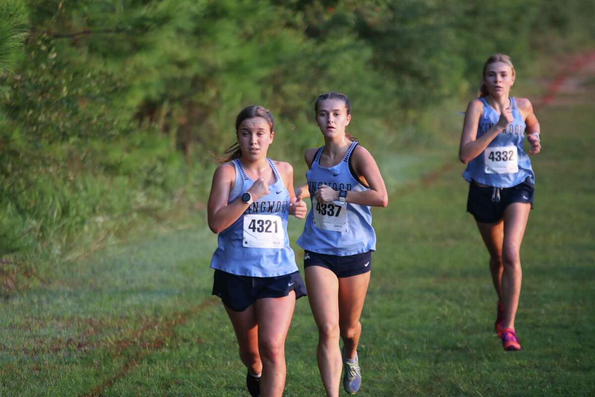 Kingwood's Jenna Carter (first), Camille Lindberg (second), Skye Hoffmann (third) running at the Andy Wells Invotational at Atascocita High School.